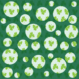 Circles. The leaves of the clover. Festive day. St. Patrick`s Day. Seamless pattern. Background for web sites, presentations, posters Royalty Free Stock Photos