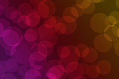 Circles of light on a pink, red and orange background. Shades of pink, red and orange used to create a Bokeh background illustration which can be used amongst Royalty Free Stock Images