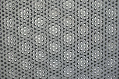 Circles metal grid gray texture steel perforated holes pattern Royalty Free Stock Photo