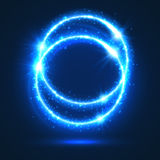 Circles of neon light flashes and sparkles. Light flashes and lights sparkles. Shiny abstract circles with neon luminous particles effect. Shining blue rings of Royalty Free Stock Photo
