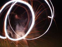 Circles in the Night. A boy makes circles in the night with a sparkler on the fourth of July Stock Image
