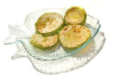 The circles of vegetable marrows fried in oil. In a saucer-small fish stock photo