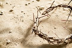 Circlet or Crown of Thorns on barren sand. With copy space in a spiritual concept of the crucifixion and Easter Royalty Free Stock Images
