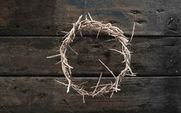 Circlet or crown of thorns on rustic wood. Symbolic of the crucifixion of Christ at Easter viewed from above Stock Image
