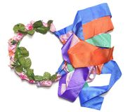 Circlet of flowers. Color circlet of flowers with long ribbons Royalty Free Stock Photo