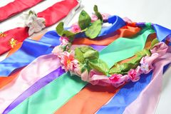 Circlet of flowers. Color circlet of flowers with long ribbons Royalty Free Stock Photography