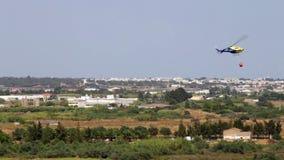 Circling fire hazardous area, Helitack.Portugal Faro Olhao stock video footage