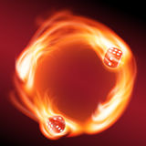 Circling two red dice in fire. Royalty Free Stock Photo