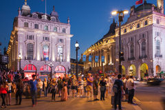 Circo di Piccadilly nella notte Londra Immagini Stock Libere da Diritti