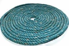 Circondi la struttura del rotolo di vecchia corda di nylon verde Fotografia Stock