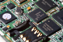 Circuit. A view of electronic circuit (inside the mobile phone), some components on it Royalty Free Stock Images