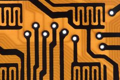 Circuit. Background: concept orange chip circuit Stock Photos