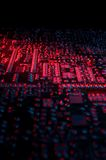 Circuit board 03. Phone mother-board close-up. Lit up in red and blue. The foreground is blurred, the background is darkened Royalty Free Stock Images