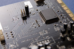 Circuit board. Black circuit board with all sorts of electronic components Stock Photo