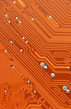 Circuit Board. Orange Computer Circuit Board closeup Stock Photography