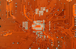 Circuit Board. Orange Computer Circuit Board closeup Royalty Free Stock Photos