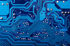 Circuit Board. Blue digital circuit board background (pc motherboard Stock Photo