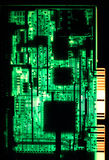 Circuit board. A circuit board from a late 1980s 286 computer, viewed from  behind and backlit Stock Photography