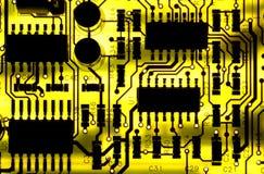 Circuit board. Back-lit yellow computer circuit board royalty free stock photo