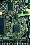 Circuit board. Green circuit board texture with various components and microprocessors Royalty Free Stock Images