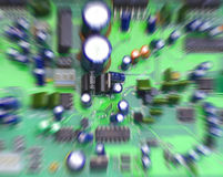 Circuit board. Colorful speaker/computer circuit board, focus on center with zoom blur Royalty Free Stock Image