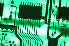 Circuit board. Electronics technology background in green Stock Photos