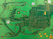 Circuit board abstract with green color. Green circuit board of a modern computer IT component Royalty Free Stock Photos