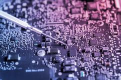 Free Circuit Board And Electronic Computer Hardware, Repair Of Electronic Control Panel, Motherboard. Royalty Free Stock Photography - 125140537