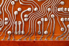 Circuit board background with soldering macro view. Retro technologies concept. Shallow depth of field photo Royalty Free Stock Images