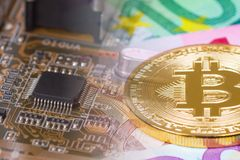 Circuit board with bitcoin and euro banknotes, cryptocurrency mi royalty free stock photography