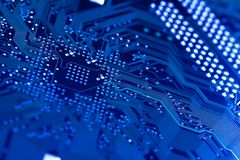 Circuit board in blue. Computer circuit board in blue.  Shallow DOF on diagonal Stock Images