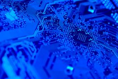 Circuit board in blue. Computer circuit board in blue.  Shallow DOF on diagonal.  Part of a series Stock Photography