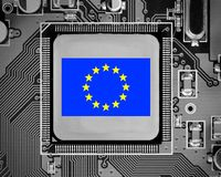 Circuit board and Chip Concept. Macro photo of circuit board and chip with EU flag letters imprinted on metal surface Stock Image