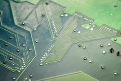 Circuit board. Chips, capacitors resistors on circuit board close up Royalty Free Stock Photo