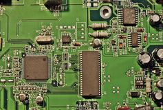 Circuit board chips landscape. Microchip in the mainboard of the computer Royalty Free Stock Photography