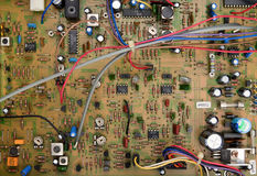 Circuit board with components. Top view of a circuit board with electrical components and colored cords Royalty Free Stock Photos