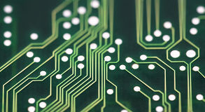 Circuit Board Connections. Green circuit board with solderings and paths Royalty Free Stock Images