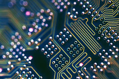 Circuit Board Connections. Blue circuit board with solderings and paths Stock Images