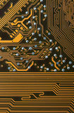 Circuit board digital highways. Close-up photo of circuit board in gold and black Stock Photo