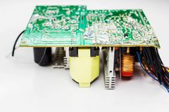 Scheme of the power supply close-up. Circuit Board and electronic components. Old technology of the past in the photo Royalty Free Stock Photo