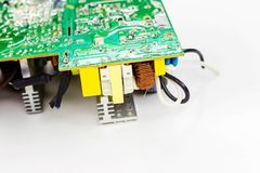 Scheme of the power supply close-up. Circuit Board and electronic components. Old technology of the past in the photo Stock Images