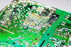 Scheme of the power supply close-up. Circuit Board and electronic components. Old technology of the past in the photo Royalty Free Stock Images