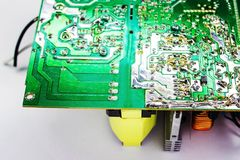 Scheme of the power supply close-up. Circuit Board and electronic components. Old technology of the past in the photo Royalty Free Stock Image