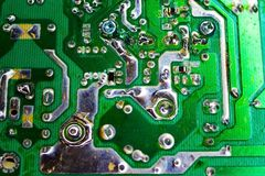 Scheme of the power supply close-up. Circuit Board and electronic components. Old technology of the past in the photo Stock Photos