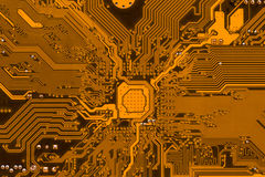 Circuit board electronics background. Orange circuit board, modern electronics background Royalty Free Stock Photo