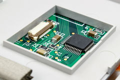 Circuit board with installed electronic components in the housing Stock Image