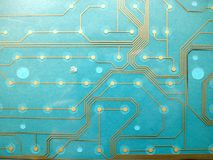 Circuit board made of plastic with circuit traces on blue background. The concept of technology, computing, electronics stock images