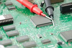 Circuit board and multimeter probes Stock Photo
