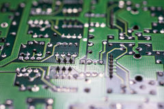 Circuit board perspective. A circuit board with a reflection of light on it Stock Photo