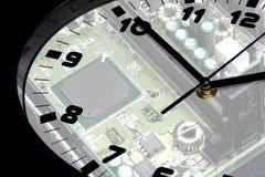 Circuit board reflected in clock Stock Image